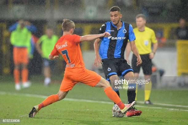 Edin Visca From Istanbul Basaksehir challenges Jelle Vossen from Club Brugge during the Champions League Third Round Qualifier First Leg match...
