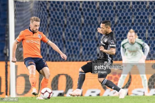 Edin Visca of Istanbul Medipol Basaksehir FK Adriano Correia Claro of Besiktas JK during the Turkish Spor Toto Super Lig match between Medipol...