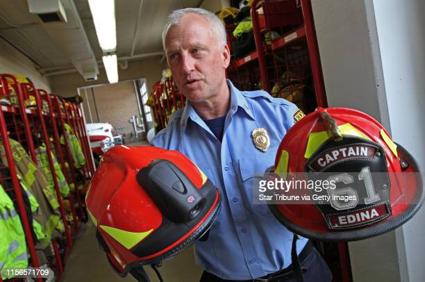 Edina Fire Capt Joel Forseth showed the new Euro style fire hat with built in flashlight and visors and the older traditional fire hat Photographed...