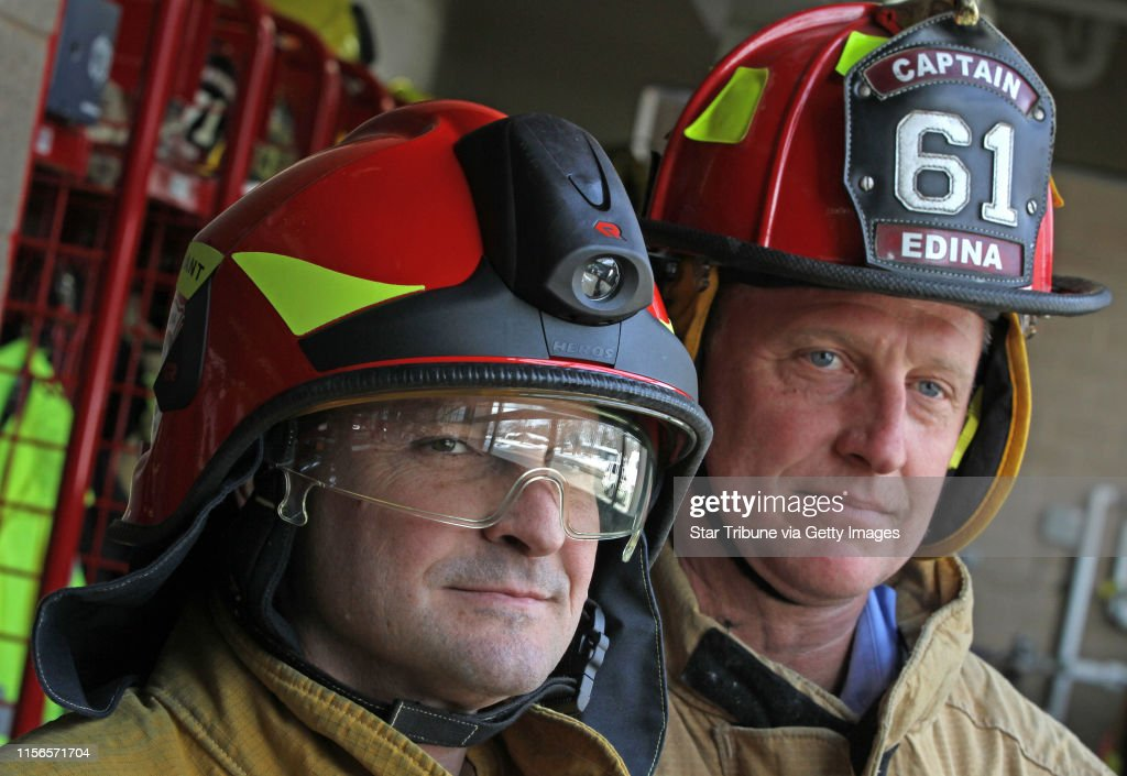 (left to right)  Edina Fire Dept. Lt. Todd Porthan wore the new Euro style fire helmet with built in light and visors and Edina Fire Capt. Joel Forseth wore the older traditional fire hat.  Photographed on 3/7/13.  In a proud profession like firefighting, : News Photo