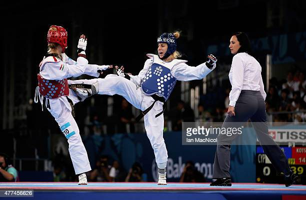 Edina Kotsis of Cyprus competes with Despina Pilavaki of Hungary during the repechage round of the WOMENS 57kg during day five of the Baku 2015...