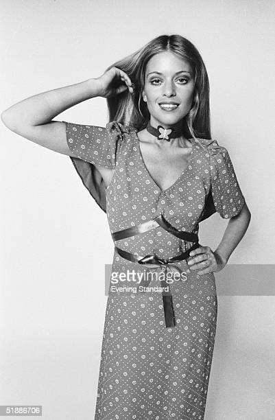 Edina Ronay modelling a patterned dress with a vshaped neckline and a butterfly motif choker 17th August 1970
