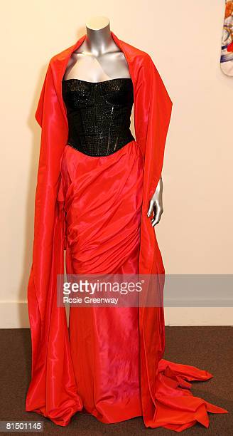 A Edina Ronay skirt and stole is displayed at a photocall prior to an auction of several of Jerry Hall's vintage dresses including the wedding dress...