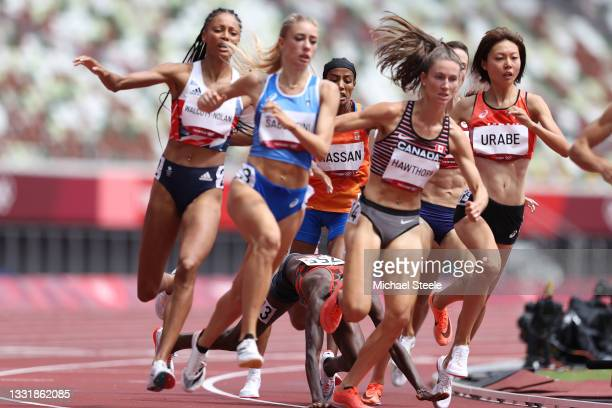 Edinah Jebitok of Team Kenya falls, tripping Sifan Hassan of Team Netherlands, in round one of the Women's 1500m heats on day ten of the Tokyo 2020...