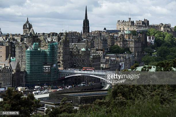 Edinburgh city centre is pictured from Calton Hill in Edinburgh, Scotland on June 27, 2016. British leaders battled to calm markets and the country...