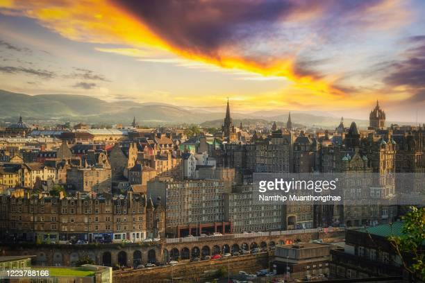 edinburgh city under colorful sky at sunset time shows various architecture of house and building. - edinburgh scotland stock pictures, royalty-free photos & images