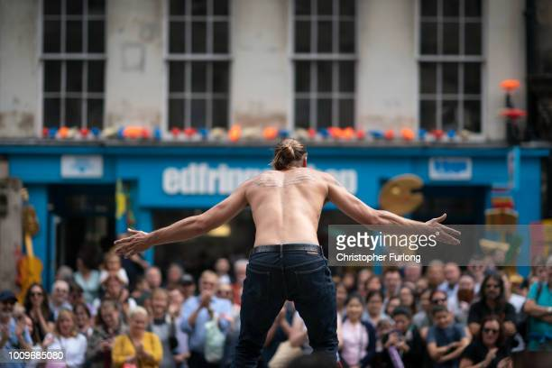 Edinburgh Festival Fringe entertainers perform and promote their shows on the Royal Mile on August 2 2018 in Edinburgh Scotland The Edinburgh Fringe...