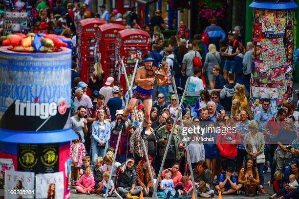 Edinburgh Festival Fringe entertainers perform on the Royal Mile on August 5 2019 in Edinburgh Scotland The festival takes place in the Scottish...