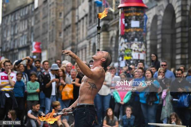 Edinburgh Festival Fringe entertainers perform on the Royal Mile on August 7 2017 in Edinburgh Scotland This year marks the 70th anniversary of the...