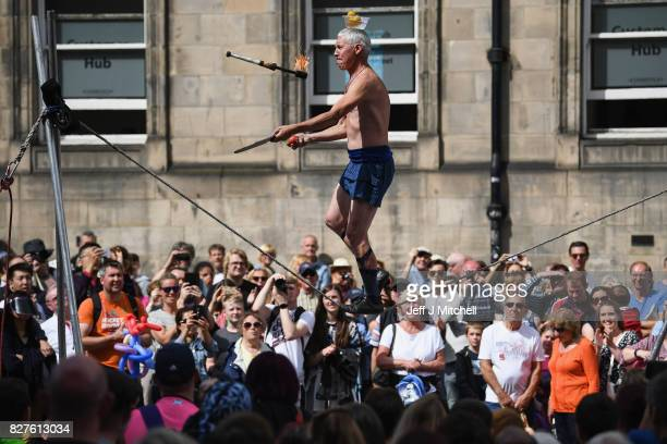 Edinburgh Festival Fringe entertainers perform on the Royal Mile on August 8 2017 in Edinburgh Scotland This year marks the 70th anniversary of the...