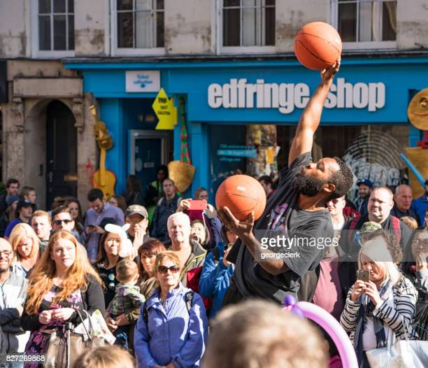edinburgh festival fringe performer on the royal mile - edinburgh festival stock photos and pictures