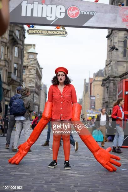 edinburgh festival fringe performer promotes show - edinburgh fringe stock photos and pictures