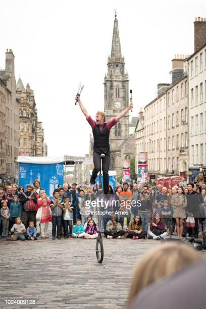 edinburgh festival fringe street performer - edinburgh fringe stock photos and pictures