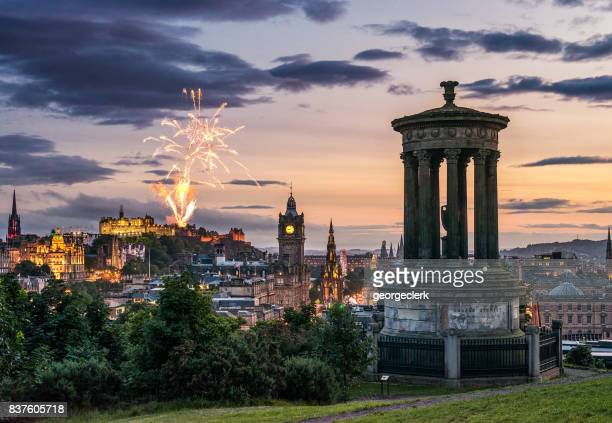 edinburgh fireworks at dusk from calton hill - scotland stock pictures, royalty-free photos & images