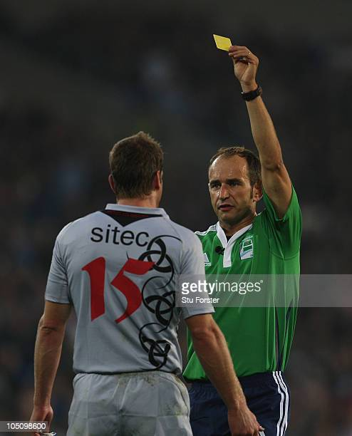 Edinburgh fullback Chris Paterson is shown the yellow card by referee Romain Poite during the Heineken Cup Pool One match between Cardiff Blues and...