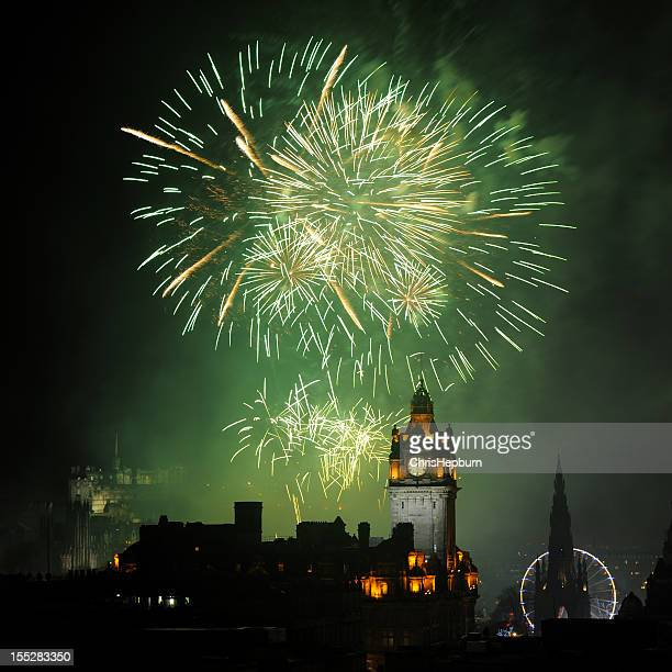 edinburgh new year's fireworks - edinburgh castle stock pictures, royalty-free photos & images