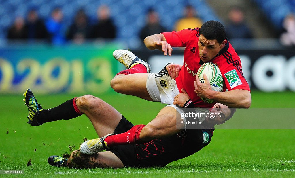 Edinburgh player Greig Laidlaw tackles Munster wing Doug Howlett during the Heineken Cup Round 5 match between Edinburgh and Munster at Murrayfield Stadium on January 13, 2013 in Edinburgh, Scotland.
