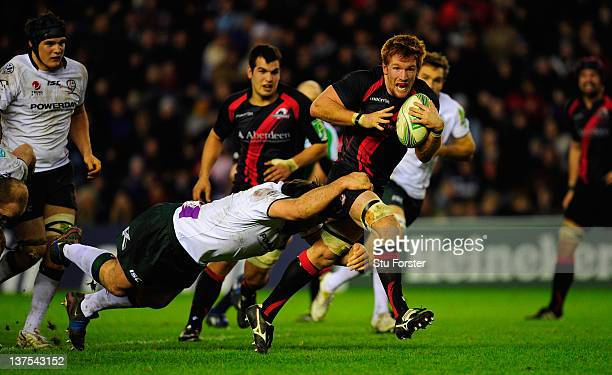 Edinburgh Rugby forward Roddy Grant races through the Irish defence during the Pool two match between Edinburgh Rugby and London Irish at Murrayfield...
