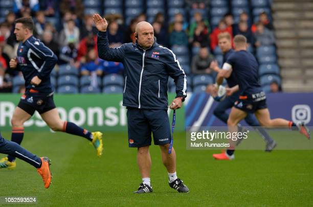 Edinburgh Rugby head coach Richard Cockerill watches his players warm up ahead of the Champions Cup match between Edinburgh Rugby and Toulon at...