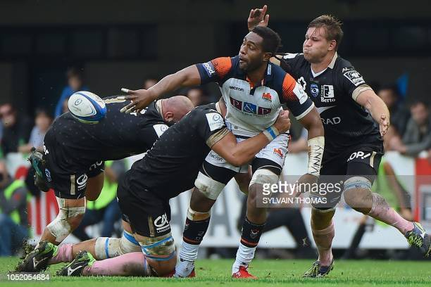 Edinburgh Rugby's Fijian Viliame Mata passes the ball during the European Rugby Champions Cup union match between Montpellier and Edinburgh at The...