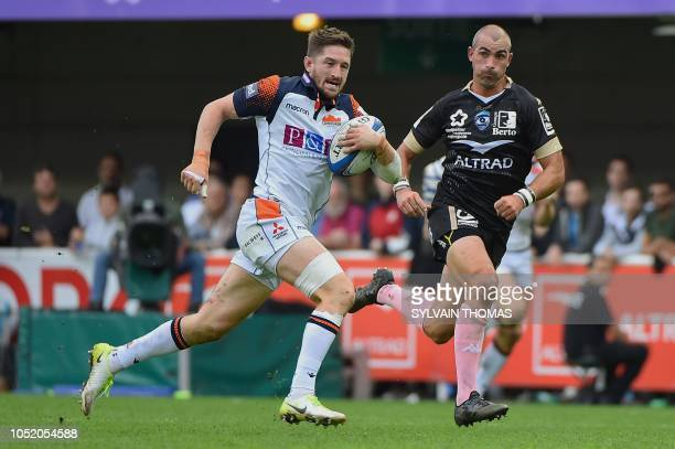 Edinburgh Rugby's Scottish scrumhalf Henry Pyrgos runs with the ball during the European Rugby Champions Cup union match between Montpellier and...