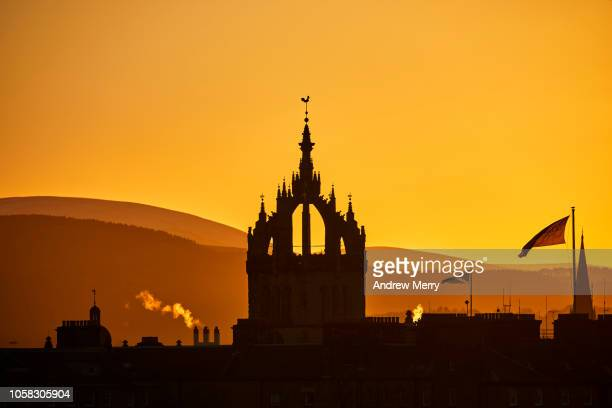 edinburgh skyline at sunset with silhouette of st giles' cathedral, pentland hills mountain range in background with yellow sky - st. giles cathedral stock pictures, royalty-free photos & images