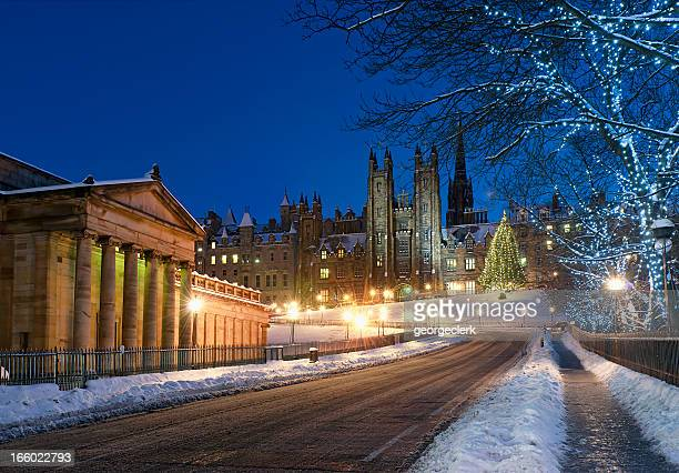 edinburgh - snow on the mound - christmas scenes stock photos and pictures