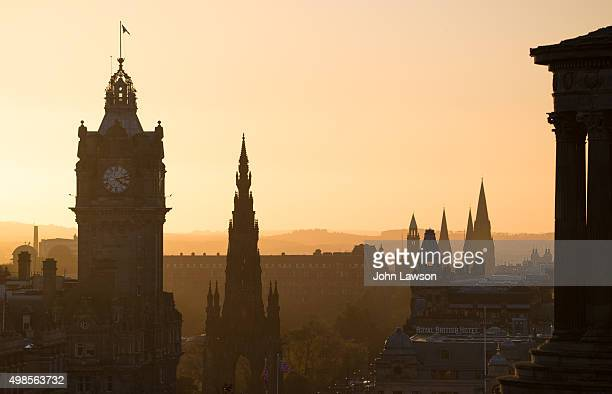 edinburgh sunset silhouette - balmoral hotel stock photos and pictures