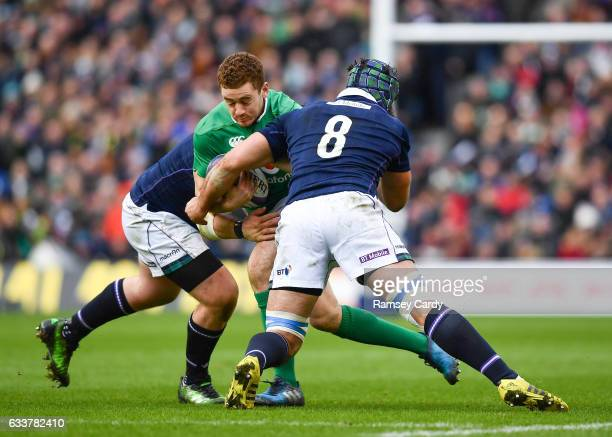 Edinburgh United Kingdom 4 February 2017 Paddy Jackson of Ireland is tackled by Zander Fagerson left and Josh Strauss of Scotland during the RBS Six...