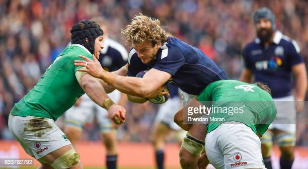 Edinburgh United Kingdom 4 February 2017 Richie Gray of Scotland is tackled by Sean O'Brien left and Iain Henderson of Ireland during the RBS Six...