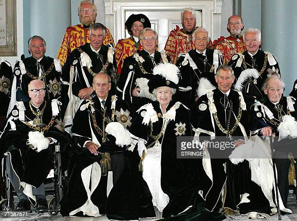 Britain's Queen Elizabeth II poses with the Duke of Edinburgh the Prince of Wales and the Knights of the Thistle in the Signet Library in Edinburgh...