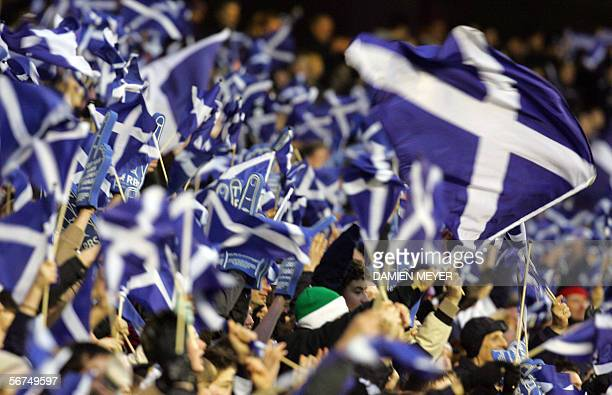 Scotland's fans wave flags after their team defeated France 2016 in the Six Nations rugby union match at Murrayfield Stadium in Edinburgh 05 February...