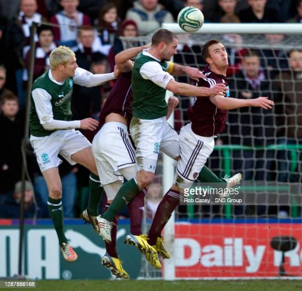 Danny Wilson battles for the ball with Hibernian pair Ryan McGivern and James McPake