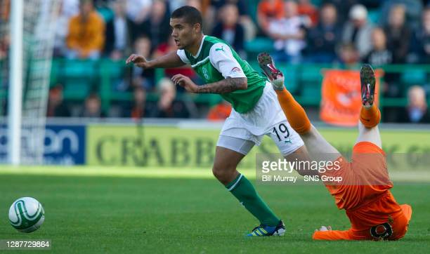 Hibernian's Victor Palsson leaves Willo Flood in a heap