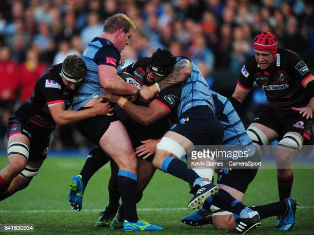 Edinburgh's Darryl Marfo is tackled by Cardiff Blues' Rhys Gill during the Guinness Pro14 Round 1 match between Cardiff Blues and Edinburgh Rugby...