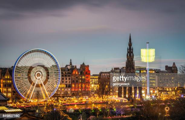 edinburgh's winter festival at dusk - new town edinburgh stock photos and pictures