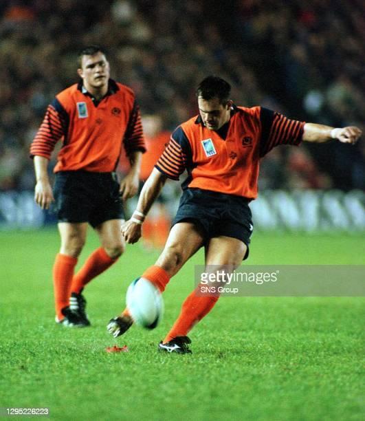 Scotland wing Kenny Logan kicks for goal.