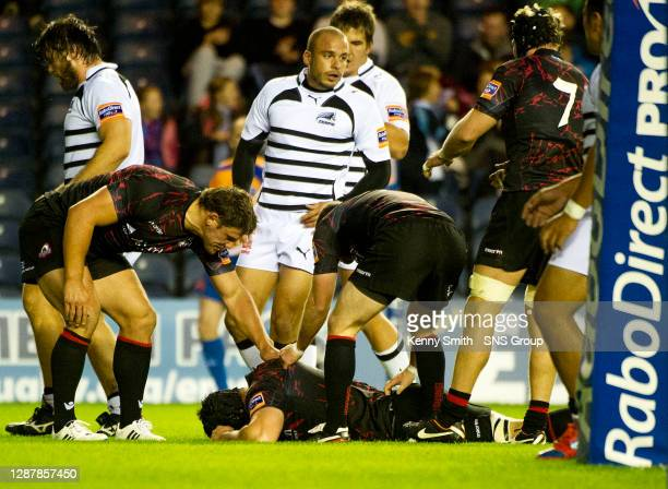 Sean Cox celebrates scoring a try for Edinburgh Rugby.