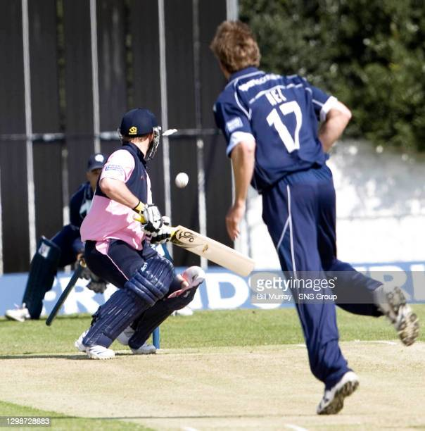 The bales fly as Scotland bowler Dewald Nel ends Phillip Hughes' time on the crease