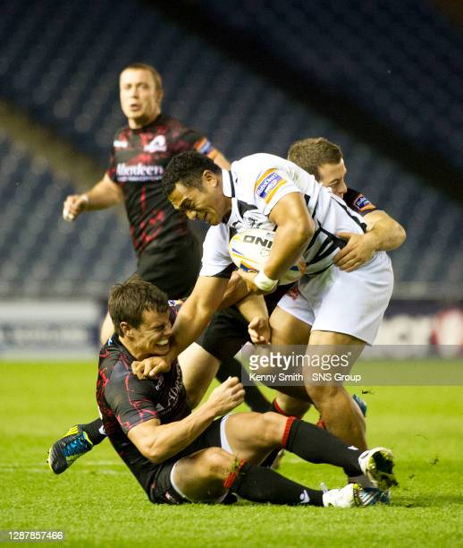 Zebre's Sinoti Sinoti fights off the Edinburgh players.