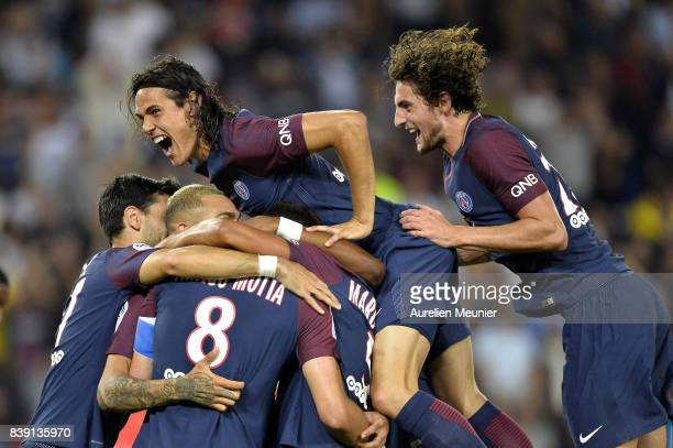 Edinson Cavani and Adrien Rabiot of Paris Saint-Germain congratulate Thiago Motta for his goal during the Ligue 1 match between Paris Saint-Germain...