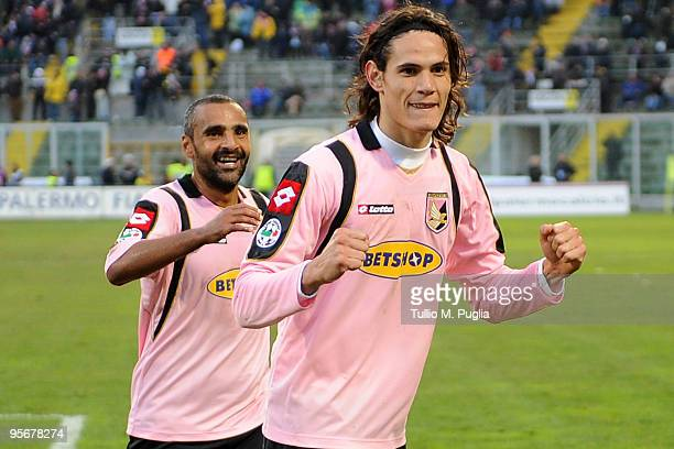 Edinson Cavani and his teammate Fabio Liverani celebrate the opening goal during the Serie A match between US Citta di Palermo and Atalanta BC at...
