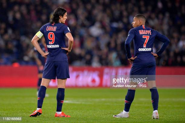 Edinson Cavani and Kylian Mbappe of Paris SaintGermain speak during the Ligue 1 match between Paris SaintGermain and Dijon FCO at Parc des Princes on...