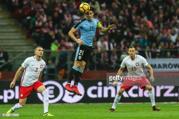 Edinson Cavani Artur Jedrzejczyk Jaroslaw Jach in action during the international friendly match between Poland and Uruguay at National Stadium on...