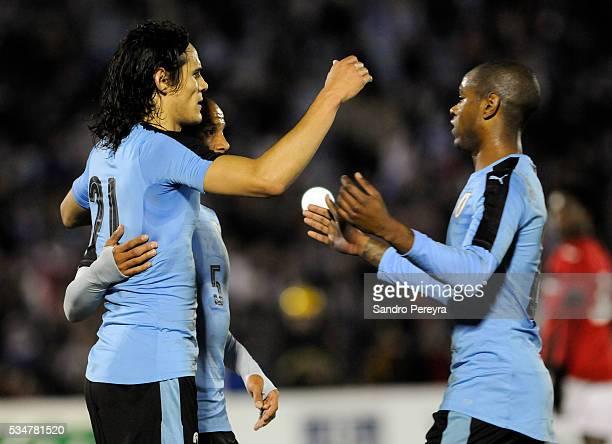 Edinson Cavani Carlos Sanchez and Diego Rolan celebrate their team's first goal during an international friendly match between Uruguay and Trinidad...