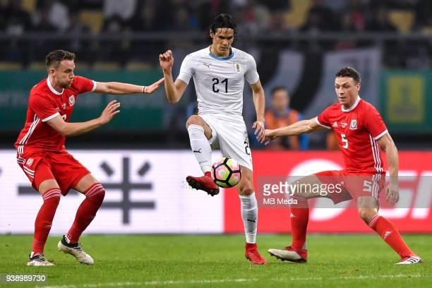 Edinson Cavani center of Uruguay national football team kicks the ball to make a pass against players of Wales national football team in their final...
