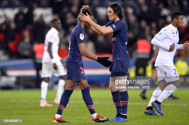 Edinson Cavani conforts Christopher Nkunku of Paris SaintGermain after he missed a goal during the Ligue 1 match between Paris SaintGermain and...