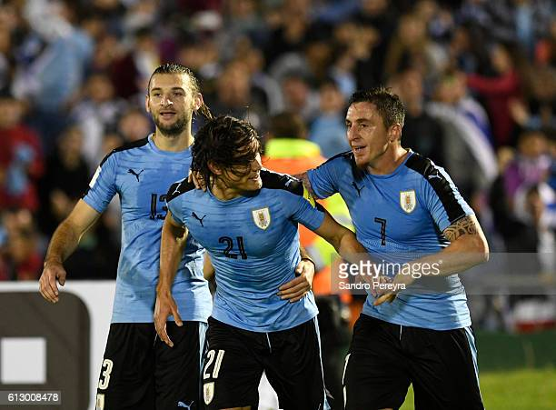 Edinson Cavani Gaston Silva and Cristian Rodriguez of Uruguay celebrate the third goal of their team during a match between Uruguay and Venezuela as...