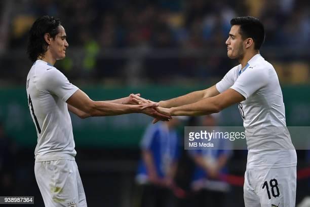 Edinson Cavani left of Uruguay national football team celebrates with his teammate Maximiliano Gomez after scoring against Wales national football...