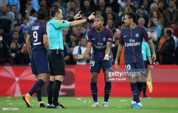 Edinson Cavani Neymar Jr Kylian Mbappe of PSG argue with referee Ruddy Buquet during the French Ligue 1 match between Olympique de Marseille and...